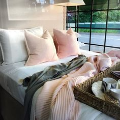 Our Luca Cushions in Soft Pink adding the finishing touches to this lovely cashmere & linen setting in the window of @haroldsfinishing_touches