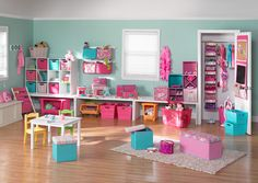 the color scheme of this playroom is sp light and fresh - i'd swap the pink for a coral or salmon - the low storage is great for the littles