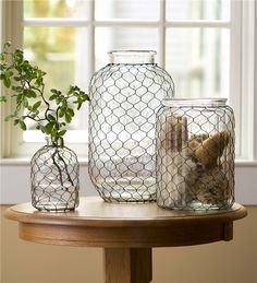 Our Large Pickle Jar Chicken Wire Glass Vase is an updated take on a vintage design. Classic chicken wire lends charm and texture to this versatile glass jar. Our vase is perfect for floral displays, kitchen utensil storage and more. Pickle Jar Crafts, Pickle Jars, Crafts With Glass Jars, Mason Jar Crafts, Large Glass Jars, Glass Vase, Chicken Wire Crafts, Wired Glass, Bois Diy