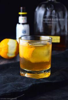 Classic old fashioned cocktail made with whiskey, bitters, simple syrup, and orange peel.