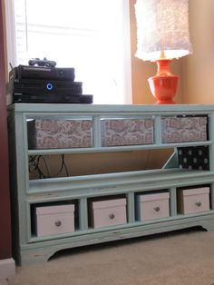 THIS BEAUTIFUL ENTERTAINMENT UNIT WAS ONCE AN u.g.l.y. DRESSER! LOVE IT!!