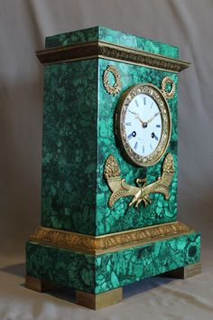 """Antique Malachite & Ormolu Clock by Rodier of Paris dated in the movement 1846.  The malachite is original to this clock & is Siberian malachite. The case has been mounted with some ormolu to give contrast but the malachite has really been left unadorned to show its own beauty. The white enamel dial is unusually signed in blue as are the chapters.  The movement is unusual and has a spring signed by Louis Gabriel Brocot.  14.5""""  x 10"""" x 5.5"""""""