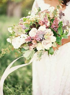 Lovely Wedding Bouquet Which Includes: Roses, Astrantia, Hellebores, Additional Florals and Foliage