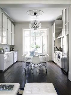 Loving the dark floors and white walls