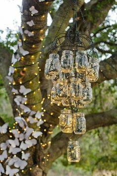 hanging mason jar chandelier for wedding decor. would be pretty w spakrley mason jars and lights Mason Jar Light Fixture, Mason Jar Lighting, Light Fixtures, Jar Chandelier, Outdoor Chandelier, Outdoor Lighting, Lighting Ideas, Homemade Chandelier, Country Chandelier