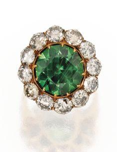 7.66-carat Russian demantoid garnet set in a diamond ring