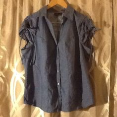 Blue polka dot button up blouse NWOT never worn. Has ruching on the sleeves. No trades or Paypal. All offers considered. torrid Tops Button Down Shirts
