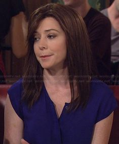 Lily's blue short sleeved button front top on How I Met Your Mother. Outfit Details: http://wornontv.net/20644/ #HIMYM