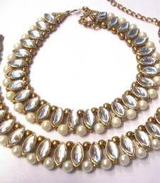 Buy Golden oval shape kundan pearl anklet anklet online