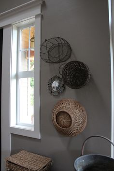 love the idea of hanging baskets on a wall... like the addition of the mirror