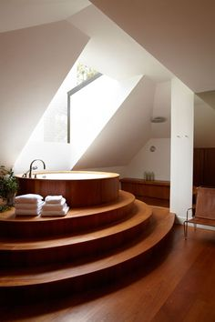 A stepped teak tub deck is the focal point of the master bath.    #home #interiordesign #decor #style #inspiration #house #bath #bathroom #bathtub