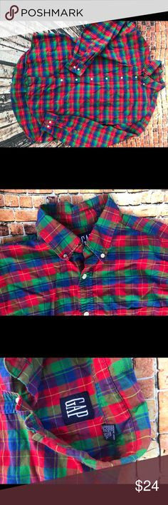 Men's Vntg Gap button down shirt This is a beautiful fall must have for the fellas .... this Plaid vintage Gap button down shirt with its red, blues , greens colourway in a Plaid print ....if your about those 90's looks pop this under a cardigan , sweater, or sweatshirt ... it claims to be an XL but fits a modern lg best .... def. must have wardrobe essential ....and it's in VGUC .... GAP Shirts Casual Button Down Shirts