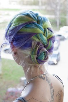 Lavender, lime, and aqua hair, french braided into a bun.