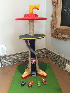 For my grandson's 3rd Paw Patrol themed birthday party, I made this cupcake tower! There is a post up the middle with 2 round platforms. It's covered with colored crispy rice treats, then fondant and/or fondant mixed with modeling chocolate makes up the details. Even the slide is colored rice treats over a wire and interfacing frame. Look for my other picture with cupcakes!