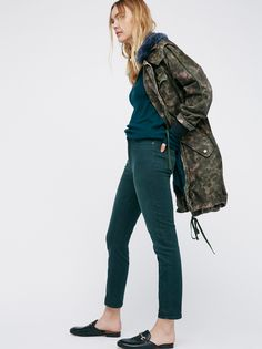 High Rise Roller Skinny  | High rise cropped skinnies with a slightly stretchy fit and playful back pocket detailing. Five pocket design with a zip fly and button closure.