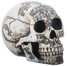 Spirits - A realistic looking skull by Nemesis Now with high detail representing the Ouija board. Made of high quality resin with a hand-painted finish. Approx. 20cm.  Product Number: D1500D5