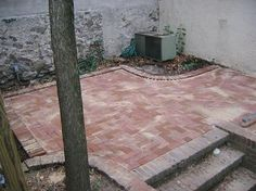 We have made a small patio in our back lawn from bricks and pavers I purchased for a grand total of $40.