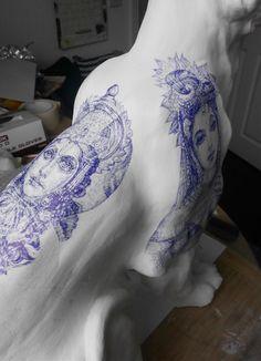 Vishnu and Lakshmi blue Biro tattoos on Tiger Sculpture