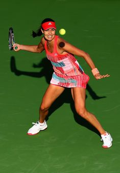 Ana Ivanovic Photos Photos - Ana Ivanovic of Serbia plays a forehand in her match against Daria Gavrilova of Australia during day two of the WTA Dubai Duty Free Tennis Championship at the Dubai Duty Free Stadium on February 16, 2016 in Dubai, United Arab Emirates. - WTA Dubai Duty Free Tennis  Championship - Day Two
