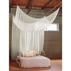 Add a romantic element to your personal or guest bed with the Cirrus Galaxie Bed Canopy. Its solid sheer construction is offset by shimmering panels on each side, creating a gorgeous covering that adds dramatic appeal to your sleeping quarters. Bed Canopy With Lights, Canopy Over Bed, Canopy Curtains, Diy Canopy, Bed Lights, Bed Canopies, Ceiling Canopy, Curtain Over Bed, Hanging Bed Canopy