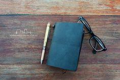 Black leather Midori Travelers Passport size with brass pen   Bookbinders Online