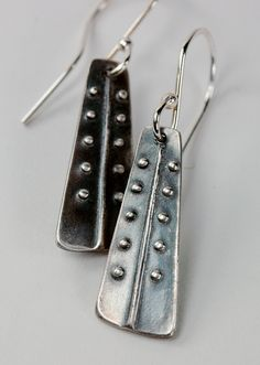 https://flic.kr/p/aTnD4X | pea coat dangle in silver | I used a custom designed stamp I made from polymer clay to create these earrings