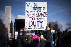 """""""When injustice become law, resistance becomes duty, #WhyIMarch,"""" the Women's March, January 20, 2018.  Photo credit: @glamourmag — in Chicago, Illinois."""