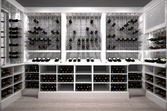 Modern white custom wine cellar featuring the Cable Wine System.