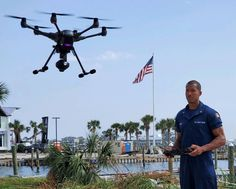 Coast Guard Petty Officer 1st Class Phillip McLeod, deployed to the post Hurricane Sally marine environmental response in Mobile, Alabama, pilots an unmanned aerial system in Pensacola, Florida to assist with pollution response.