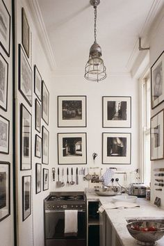 Galley kitchen done well. I like all the pictures on the walls for character White Kitchen, Tiny Kitchen, Kitchen Design, Small Galley Kitchens, Home Kitchens, Small Kitchens, French Kitchens, Small Bathrooms, Black Kitchens, Cozy Kitchen, Narrow Kitchen, Kitchen Black