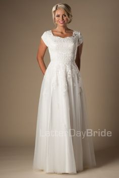 Modest Wedding Dress   LDS Bridal Gown   LatterDayBride & Prom   SLC   Utah   Worldwide Shipping   2017 Collection   Under $500   Evelyn   This lovely modest wedding gown features a lovely lace bodice, natural waistline and cascading sheath tulle skirt.      Gown available in Ivory or White    *Gown pictured in Ivory
