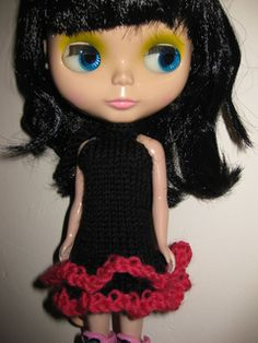 Halter neck dress for Blythe with ruffled skirt. Knitted flat from the bottom up.