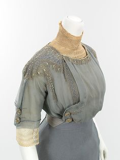 Close up of Walking suit (a–c) House of Paquin  (French, 1891–1956) Designer: (a–c) Mme. Jeanne Paquin (French, 1869–1936) Designer: (d) Thurn (American) Date: spring/summer 1910 Culture: French Medium: wool, metal, silk