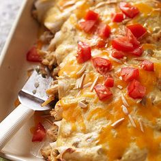 Creamy Chicken Enchiladas made with light sour cream, yogurt, diced green chile peppers and spinach