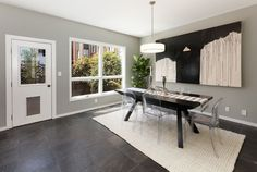 A slate tile floor lines a dining room that includes a pet door and yard access. Photo: Steph Dewey/Reflex Imaging