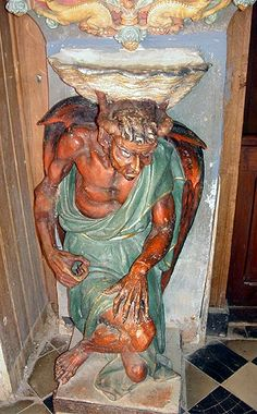 Holy Water Fount, Church of St. Mary Magdalene, Rennes-le-Chateau, France -- why would a Catholic Church have the Devil depicted on a Holy Water Fount and what is the mystery of Fr. Berenger Sauniere and Rennes-le Chateau?