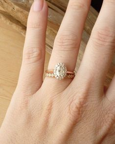 Oval Moissanite and Diamond Halo by kateszabone on Etsy - My perfect engagement and wedding ring :) really I love with it! It has that vintage beauty. Love it.