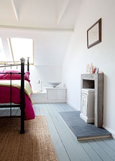 Lucy Dunce, British Isle Ceramicist, Edinburgh home, hot pink bedspread, bedroom with painted pale blue gray wood floors