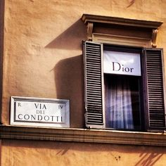 Via dei Condotti, Roma.  The most expensive street, a luxe shopping destination...the jewel at the end of the street is The Spanish Steps!