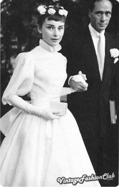 September 25, 1954, Audrey Hepburn married actor Mel Ferrer  after starring with him on Broadway in the play Ondine. She wore a typically full-skirted Fifties ballerina-length style by Pierre Balmain with roses in her hair.  Photo By PA Photos