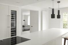 Minimal white kitchen by Nicolas Schuybroek in Brussels