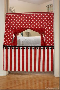 """Great tutorial from the Crafty Cupboard.  One thing we don't have a lot of is space, so it makes sense to utilize every. single. spot in our condo the best we can. Doorways aren't just for doors anymore… it is all about this cute Puppet Theatre.Begin with your cut fabric pieces:POLKA DOTS: (1) at 14"""" x 36"""", (2) at 8"""" x 13""""STRIPE: (1) at 29"""" x 36""""CURTAIN: (2) at 12"""" x 14""""DOWEL POCKET: (1) at 1 1/2"""" x 34"""""""