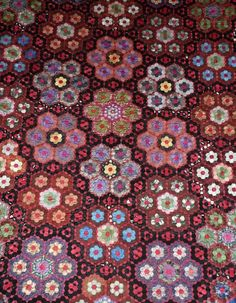 detail from antique quilt made of silk circa 1860