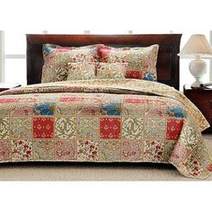 This wont bring a shabby look to my bedroom furniture, but will allown me to incorporate the things like the green rug and maternity picture and peach accents...@Overstock - Comfortable and colorful, this quilt set will update your bedroom decor. Kimset prints in shades of yellow, green, red and blue cover this wonderful quilt and sham set.http://www.overstock.com/Bedding-Bath/Kismet-King-size-Quilt-Set/5870140/product.html?CID=214117 $77.99