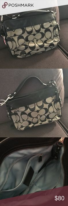 Coach Zoe Signature Hobo Purse Black and Grey Coach Signature fabric and trimmed with black leather and silver hardware. Leather strap with dog leash end. Interior zipper and Pocket. Zippered top with lined interior Approx. 13 inches wide, 10 inches tall and 4 inches deep Coach Bags Hobos
