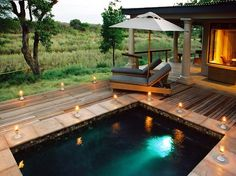 MalaMala Game Reserve, Sabi Sand  Kruger National Park, South Africa    Game seekers who take refuge in one of the eight khayas (suites) at Rattray's on MalaMala can indulge in a post-safari swim in their personal pool. Located on their private veranda, the swimming holes all afford vantage points to scan the Sand River for birds and other small creatures.