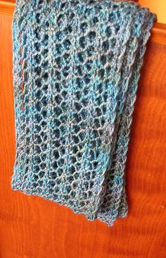 This pattern makes a beautiful reversible lace scarf that can be knitted in different yarns. An opportunity to use that fingering weight wool, soft alpaca, perhaps some of your sock yarn or sport weight yarn.