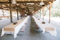 Rustic outdoor wedding at Paramount Ranch, with picnic tables...AND hanging chandeliers! DIY Burlap table runners, wooden succulent flower boxes, and ivory lace linens