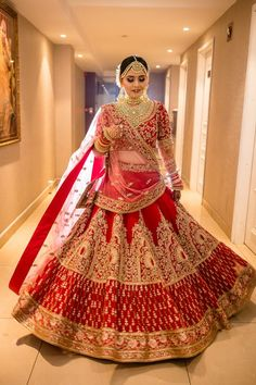 Looking for Bride in a heavy red and gold bridal lehenga? Browse of latest bridal photos, lehenga & jewelry designs, decor ideas, etc. Indian Bridal Photos, Indian Bridal Outfits, Indian Bridal Fashion, Indian Fashion Dresses, Indian Designer Outfits, Wedding Lehenga Designs, Indian Wedding Lehenga, Designer Bridal Lehenga, Red Saree Wedding