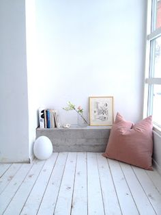 Pale wood and white walls.